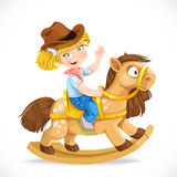 Cute little girl sits on the toy rocking horse Royalty Free Stock Image