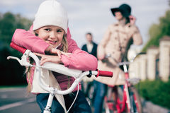 Cute little girl sitting on bicycle Royalty Free Stock Photo