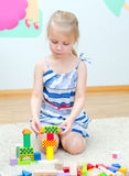 Cute little girl playing with building blocks Royalty Free Stock Images
