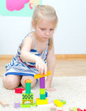 Cute little girl playing with building blocks Stock Image