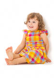 Cute little girl sitting on the floor Royalty Free Stock Photography
