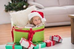 Cute little girl sitting in giant christmas gift Stock Image