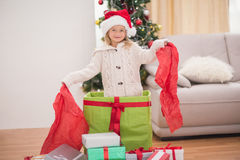 Cute little girl sitting in giant christmas gift Royalty Free Stock Images