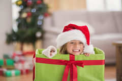 Cute little girl sitting in giant christmas gift Stock Photos