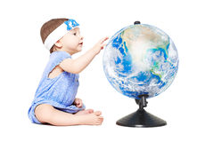 Cute little girl sitting with a globe Stock Photo
