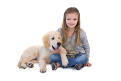 Cute little girl sitting with her dog Stock Image