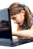 Cute little girl is sitting  with her laptop Stock Images