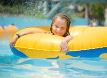 Little girl sitting on inflatable ring Stock Photo