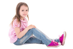 Cute little girl sitting isolated on white Stock Photos
