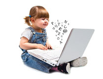 Cute little girl sitting with a laptop Royalty Free Stock Photos