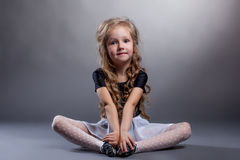 Cute little girl sitting in lotus position Stock Images
