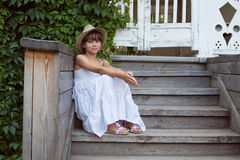 Cute little girl is sitting Royalty Free Stock Photo