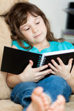 Little girl reading Royalty Free Stock Photography