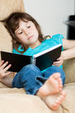 Little girl reading Royalty Free Stock Photo