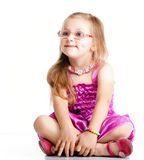 Cute little girl sitting and smiling,  Royalty Free Stock Images