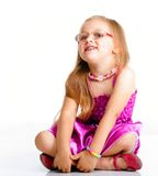 Cute little girl sitting and smiling, isolated Stock Images