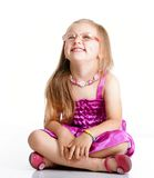 Cute little girl sitting and smiling, isolated Royalty Free Stock Photos