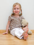 Cute Little Girl Sitting With Teddy Bear Royalty Free Stock Photo