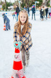 Cute little girl on skating rink Royalty Free Stock Photo