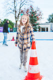 Cute little girl on skating rink Royalty Free Stock Images