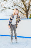 Cute little girl on skating rink Royalty Free Stock Photos