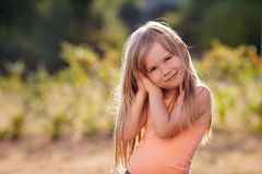 Cute little girl with skirt, dancing and swirling around, summer Royalty Free Stock Photos
