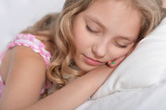 Cute little girl sleeping Stock Images