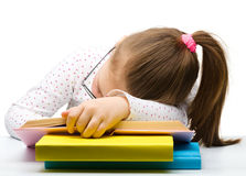 Cute little girl is sleeping on a book Stock Images