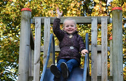 Cute little girl on slide Stock Photo
