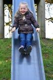 Cute little girl on slide Stock Photos