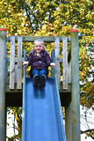 Cute little girl on slide Stock Photos