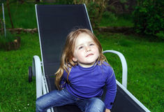 Cute little girl on sling chair Royalty Free Stock Photography
