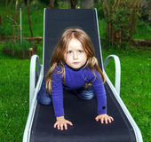 Cute little girl on sling chair Royalty Free Stock Images