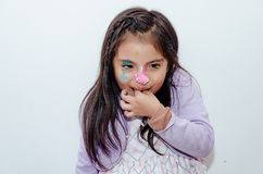 Cute little girl smeared with cake on her face royalty free stock image