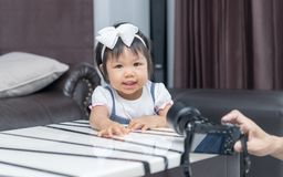 Cute little girl smile and take picture. In house Royalty Free Stock Images
