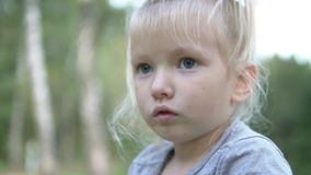 Cute little girl is smiling stock video footage