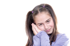 Cute little girl smiling dreamily Royalty Free Stock Image