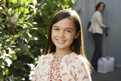 Cute Little Girl Smiling In Frontyard Royalty Free Stock Photography