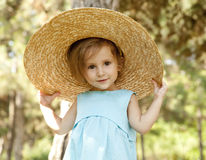 Cute little girl smiling in a park Stock Images