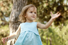 Cute little girl smiling in a park Royalty Free Stock Photos