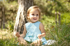 Cute little girl smiling in a park Stock Photography
