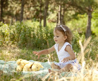 Cute little girl smiling in a park Royalty Free Stock Images