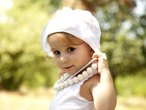 Cute little girl smiling in a park Royalty Free Stock Photo