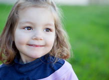 Cute little girl smiling in the park Royalty Free Stock Image