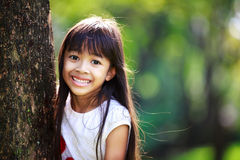 Cute little girl smiling in a park Royalty Free Stock Photography