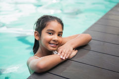 Cute little girl smiling in the pool Stock Photos