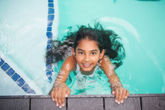 Cute little girl smiling in the pool Royalty Free Stock Photography