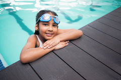 Cute little girl smiling in the pool Royalty Free Stock Photo
