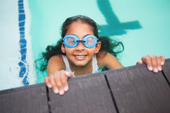 Cute little girl smiling in the pool Stock Photo
