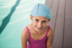 Cute little girl smiling poolside Stock Photo